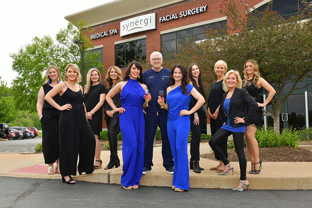 The Staff of Synergi Med Spa posing in celebration
